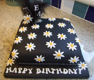 black with white daisy birthday cake