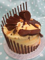 Chocolate Orange cake with Terry's and Matchmakers, candied orange, and swirly buttercream
