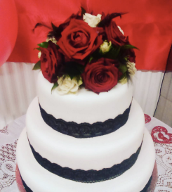 iced wedding cake with fresh flowers