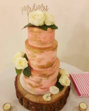 Pink and gold naked cake wedding cake