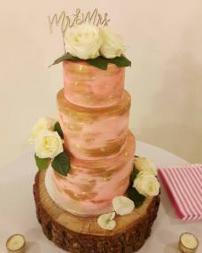 Pink and gold naked cake wedding cake
