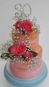 Pink naked cake with flowers for birthday